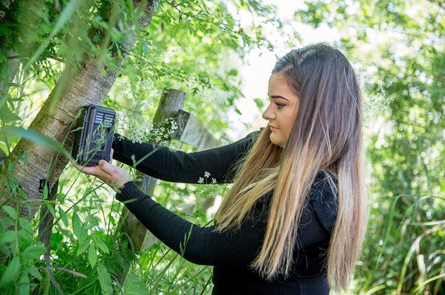 Student using camera trap