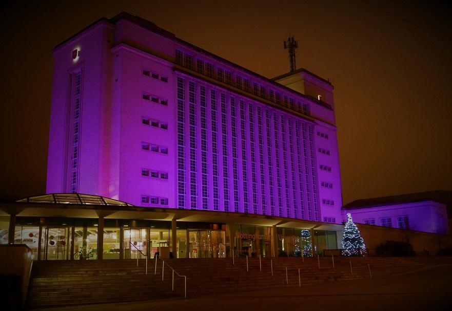Newton building lit up by purple lights