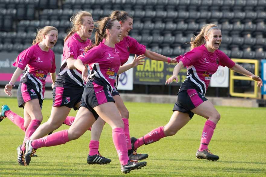 The Womens Football team celebrating a goal