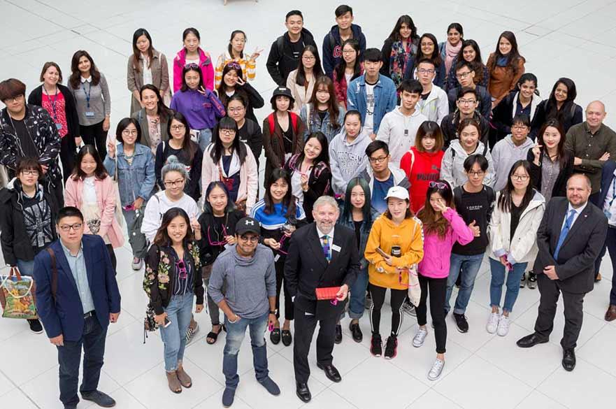 International students and NTU Global staff in Newton building Atrium