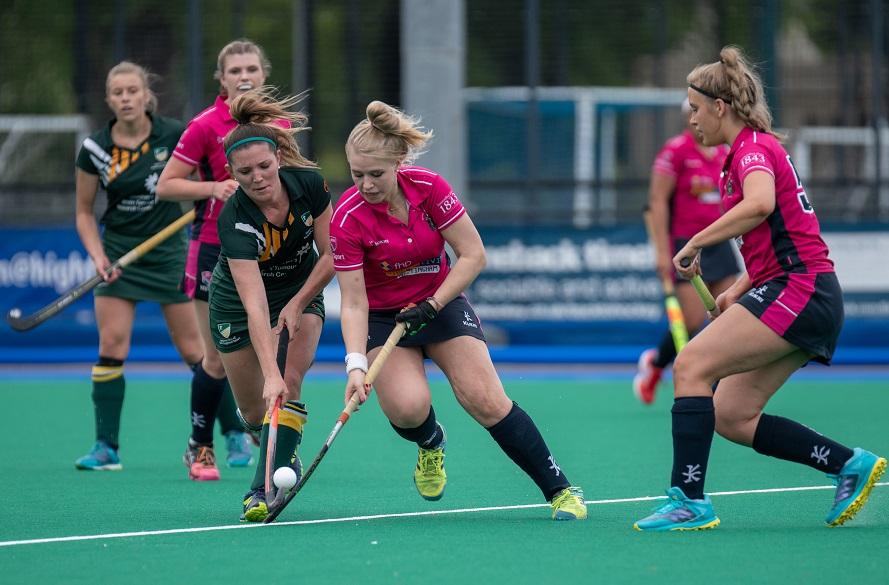 NTU Female hockey player running with the ball
