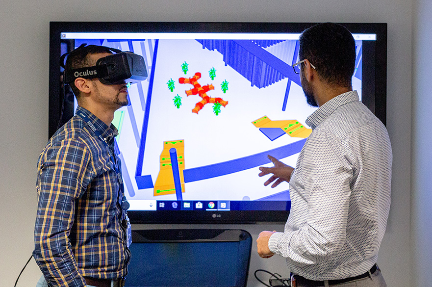 Academic and postgraduate researcher using the virtual reality technology in the creative and virtual technologies laboratory