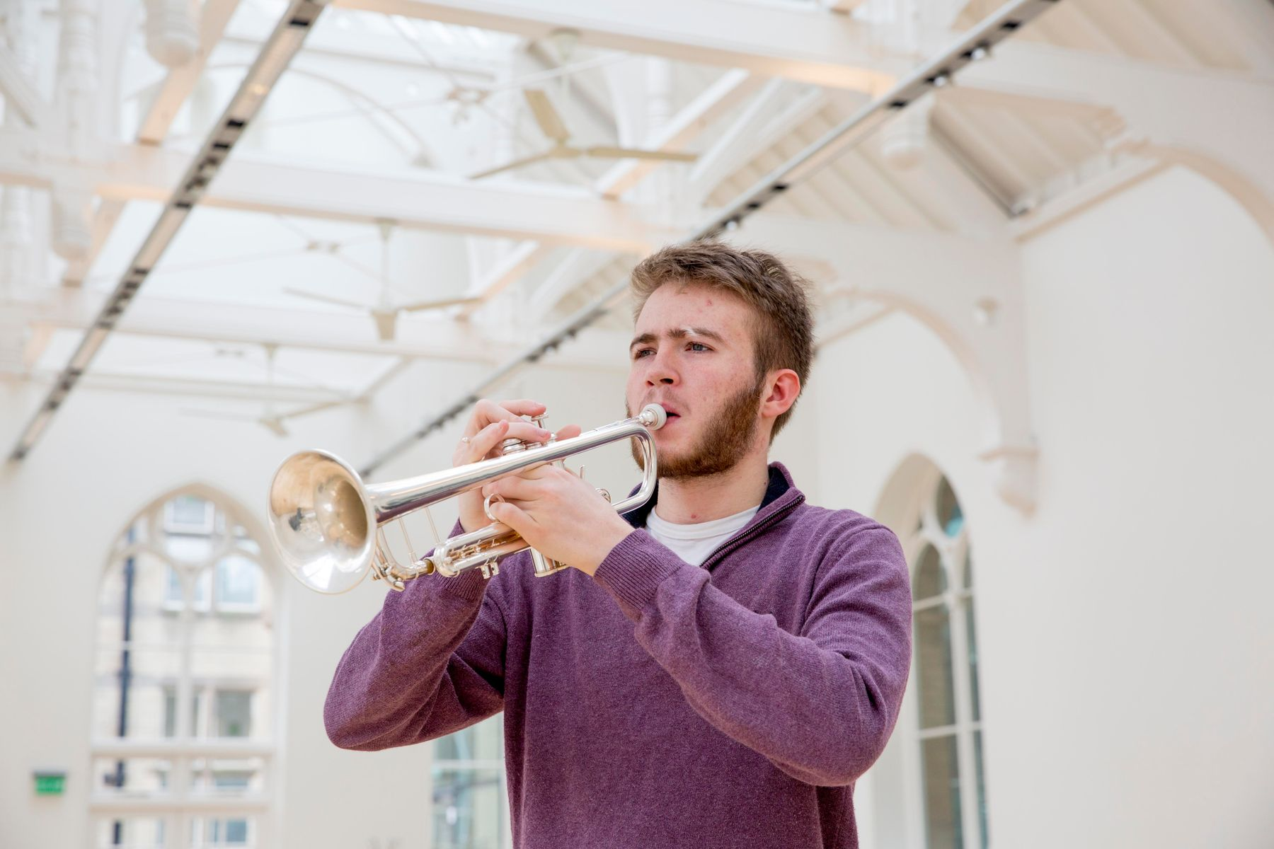 Male student playing trumpet