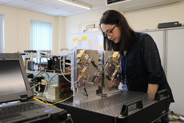 Photograph of student working on machinery