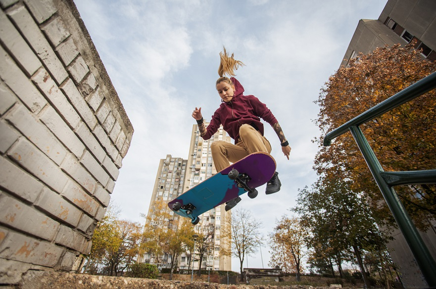 Female skateboarder performing a jump