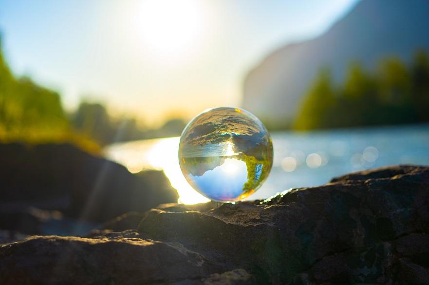 glass ball reflecting a lake