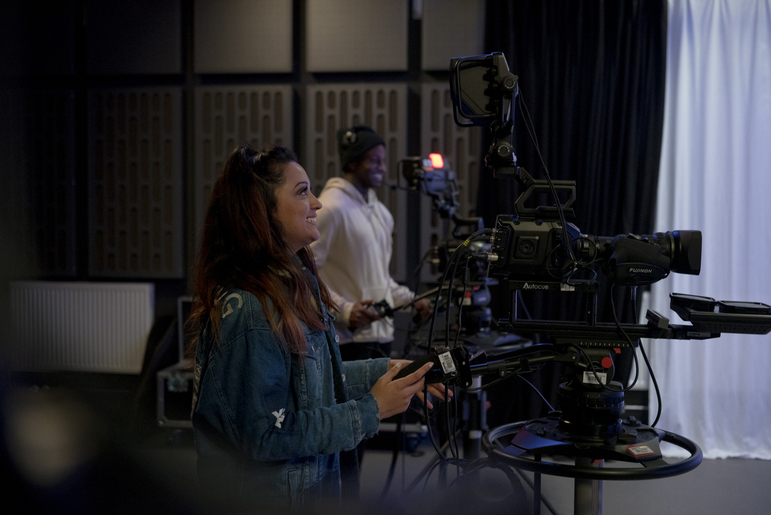 Students using a camera in a studio