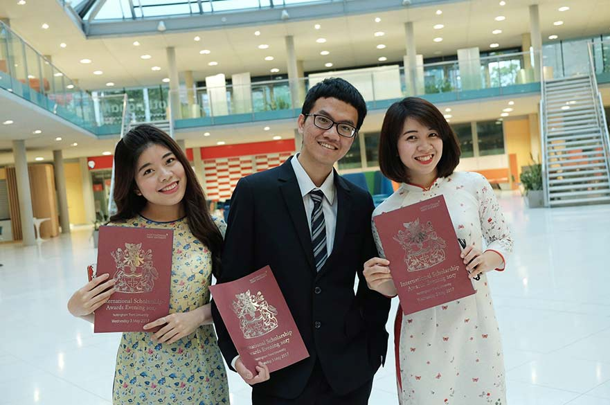 Students with scholarship certificates