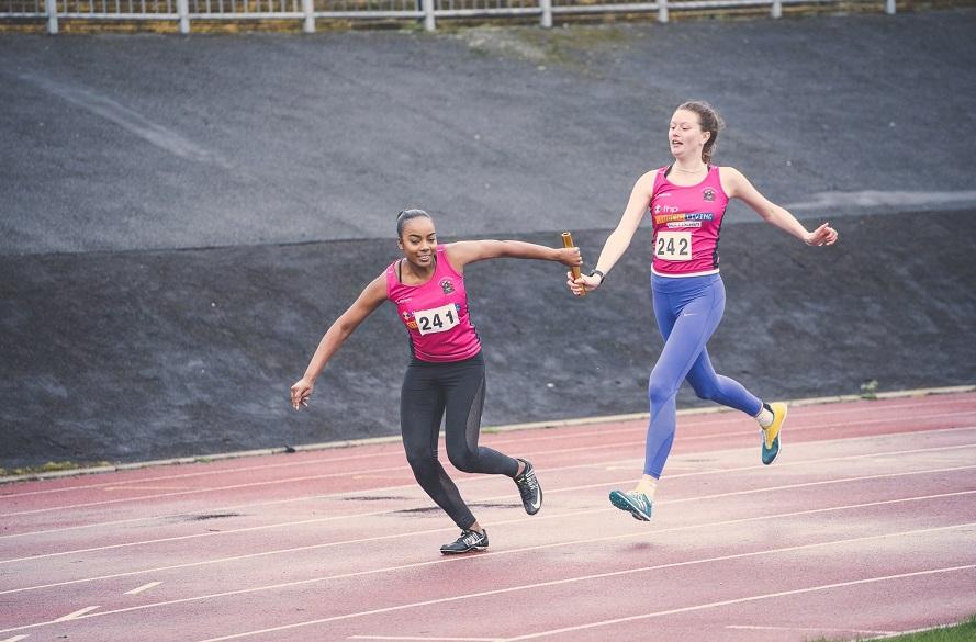 NTU students running with baton