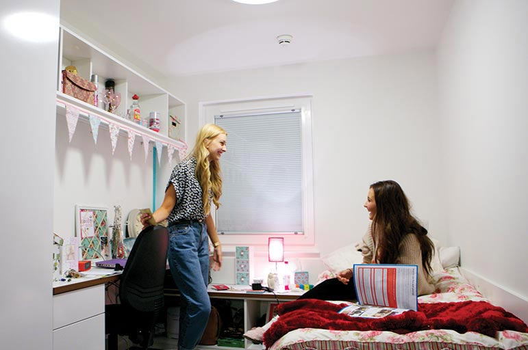 two female students in a Gill Street bedroom