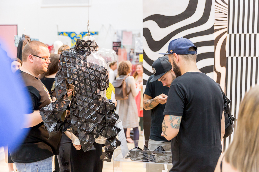 Visitors looking at exhibition