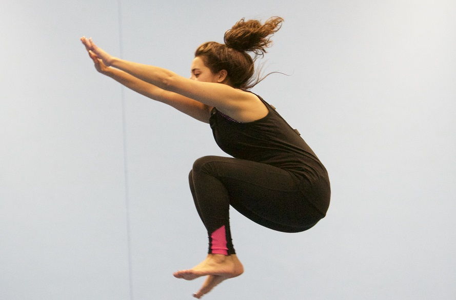 Female doing trampolining