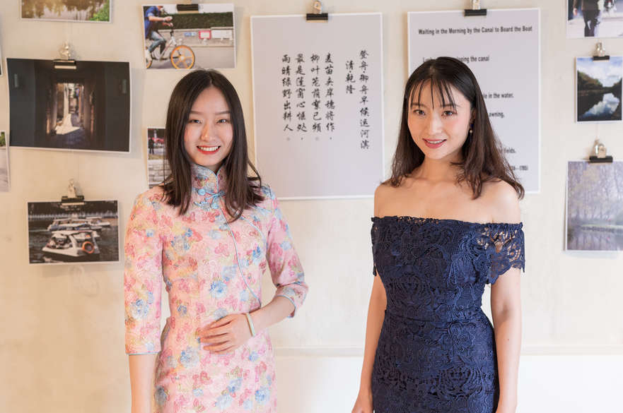 Two Chinese students performing poetry