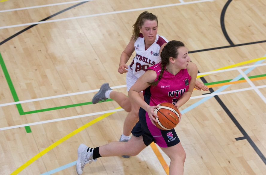 Female NTU Women's Basketball player with ball in hand