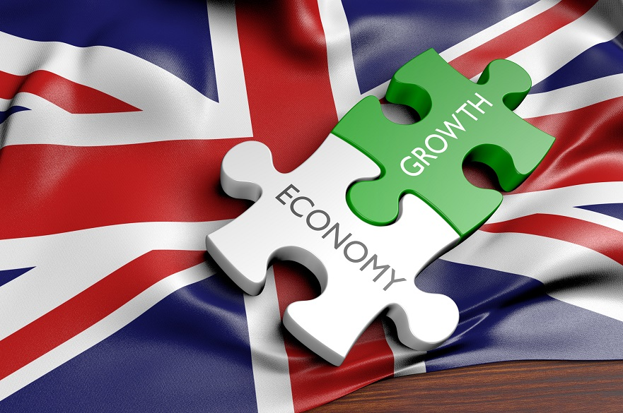 Union Jack with economy and growth jigsaw pieces