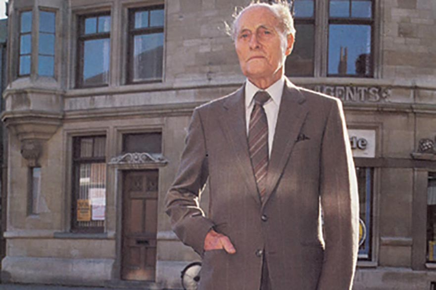 John Van Geest outside his first office in the Spalding building