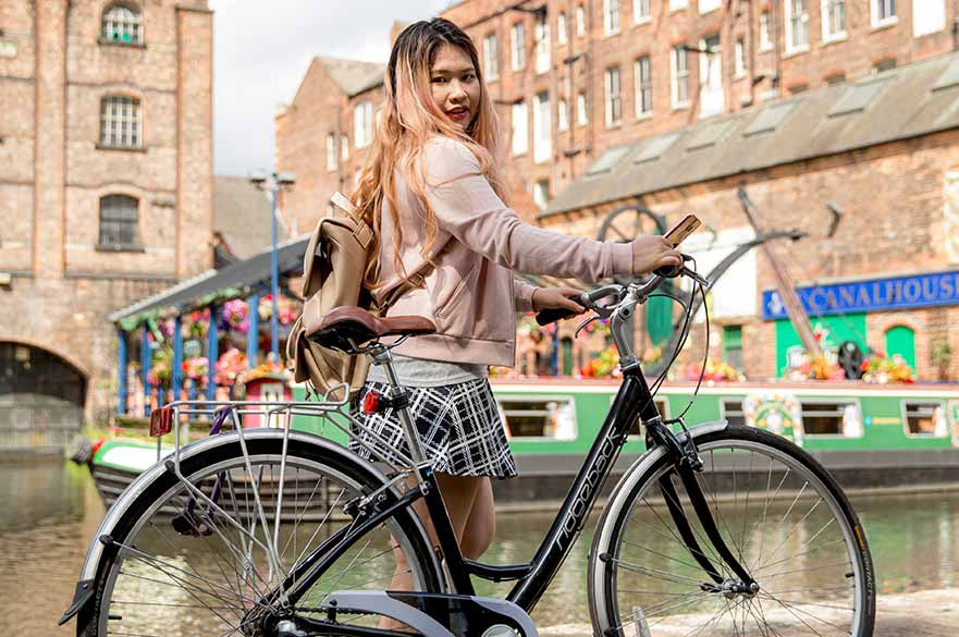 Girl waterfront with bike