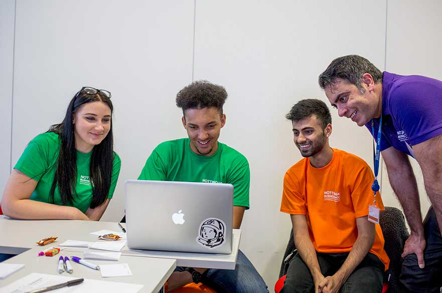 Students at a table taking part in Thinkubator