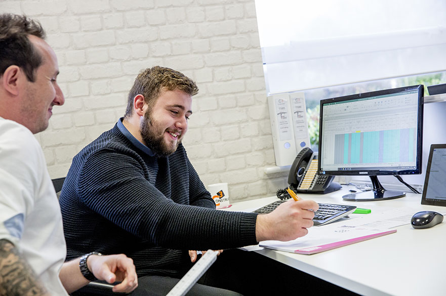 Level 6 Quantity Surveyor Degree Apprenticeship student with his workplace mentor from C3 Construction