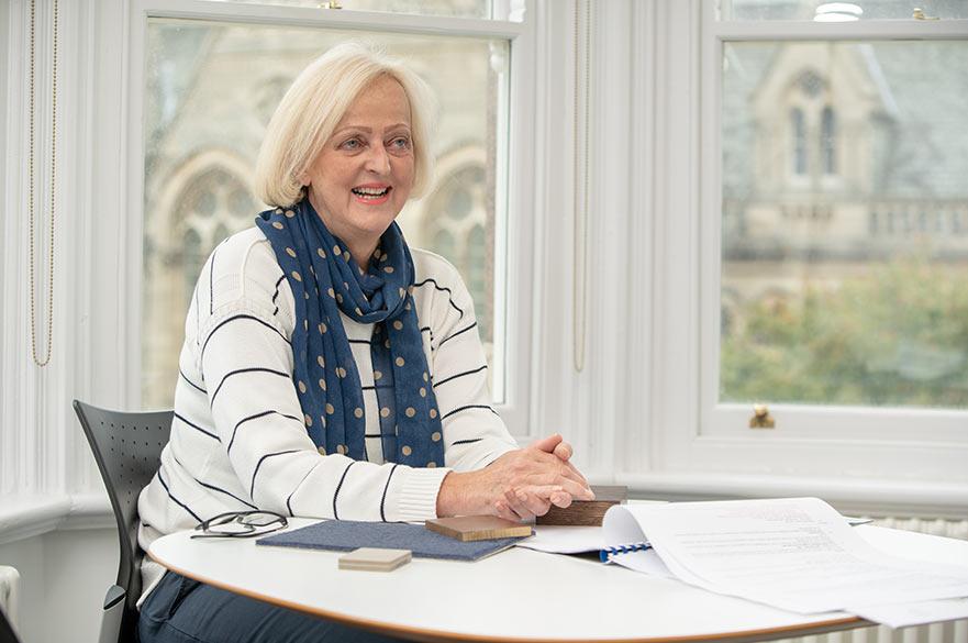 Michelle Pepin sitting at desk