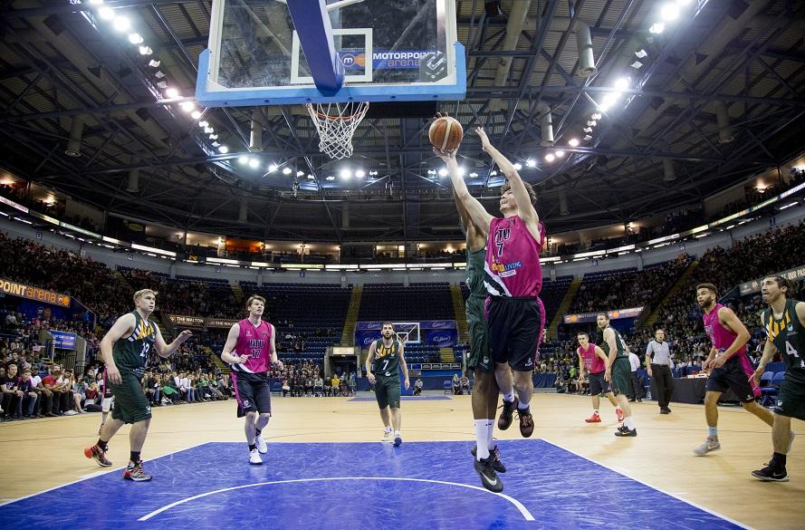 NTU Men's Basketball player attempts a shot