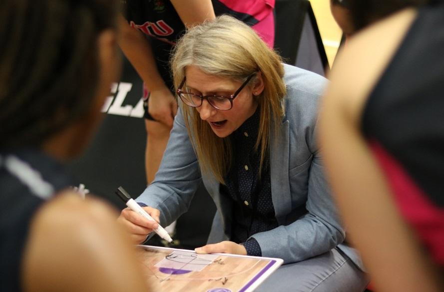 NTU Women's Basketball Coach strategising